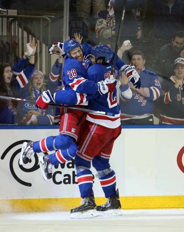 Dominic Moore jumps Into Dan Boyle's arms after a goal in game 5 of the 2014 Stanley Cup Playoffs – Getty Images